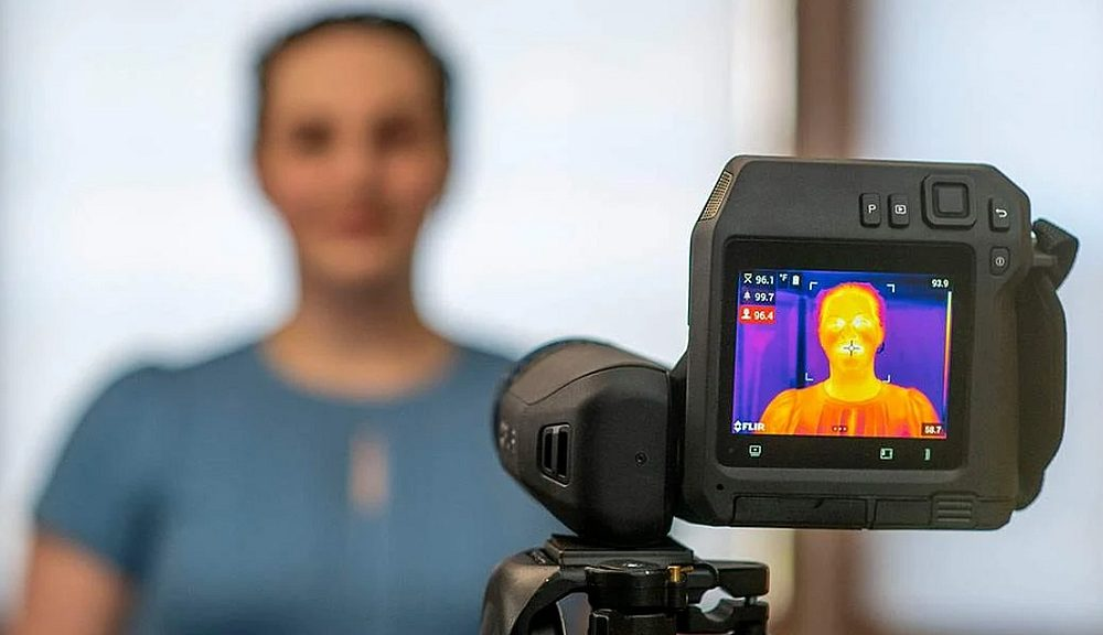 Temperature measurement of a face with an infrared camera from Flir